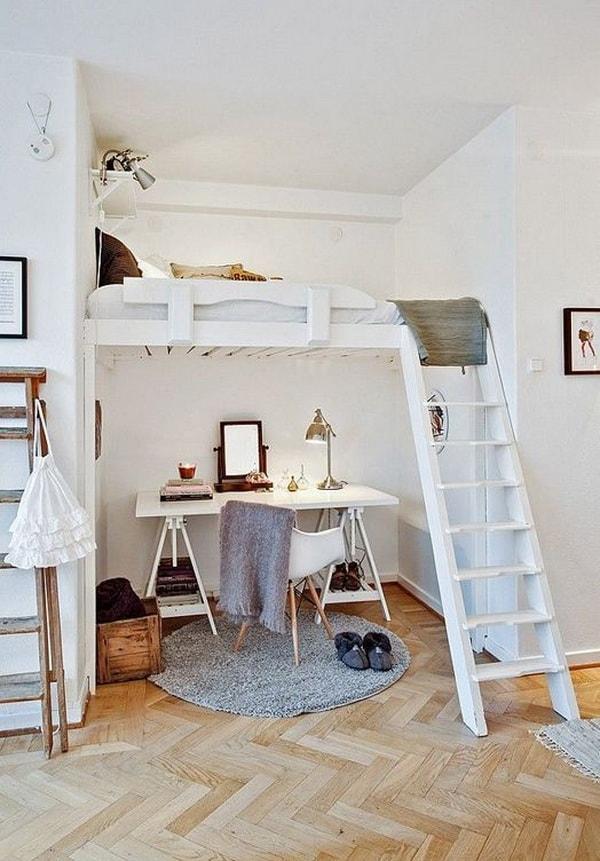 Dormitorio tipo loft con suelo de madera